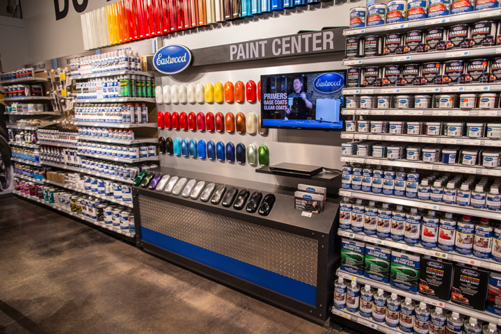 paint display wall with canopy lighting