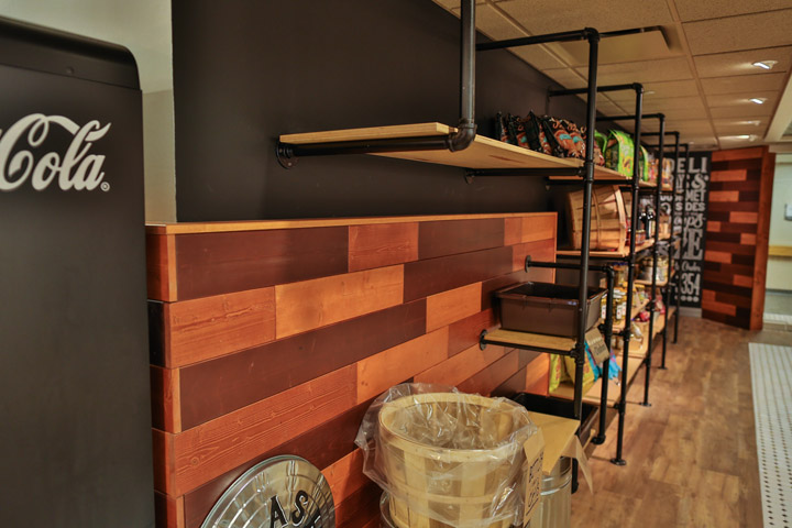 wood-panel wall pipe-rail shelves
